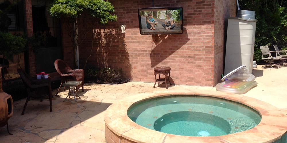 Outdoor TV cabinet on a patio