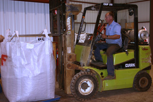 Forklift Lifting a Huge Bag of Pecans