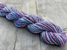 "Hand Dyed and Hand Spun ""Corespun Singles"", 60% Merino/40% bamboo rayon thick and thin corespun on a mohair blend yarn"