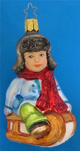 Winter Fun Boy Sledding Glass Christmas Ornament