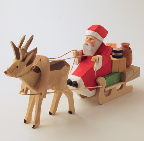 Wooden german santa with reindeer figurine