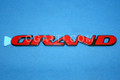 10255622 | GRAND RED Pontiac Grand Prix FRONT DOOR EMBLEM