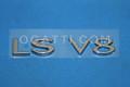 1W4Z-5442528-AA | LS V8 LINCOLN LUGGAGE EMBLEM LUGGAGE 2000-2001