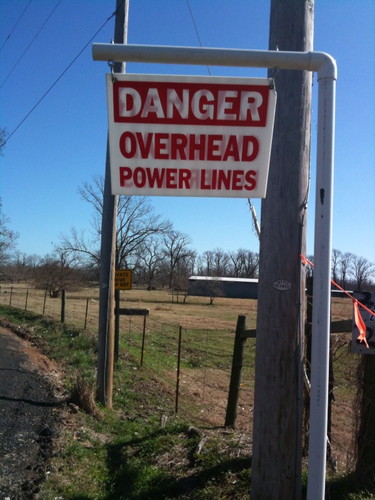 Danger Overhead Power Lines Sign - 18x24 - Red Letters on White Coroplast