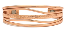Magnetic copper bracelet honoring the changing tides.