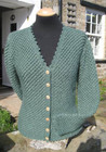 Ladies hand-knitted Smarber cardigan in forest green Wensleydale wool.