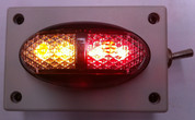 Oversize, Over Dimension Clearance Light. Amber Red. On Off Switch. Magnetic Mount. Wireless, Battery Operated. Picture is with the Light Operating. Light is ADR Approved. Hand made by Ultimate LED