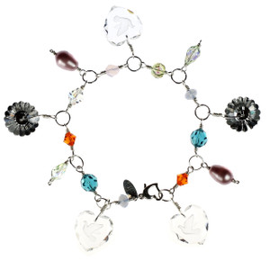 This sexy and elegant charm bracelet is a limited edition piece of jewelry by the Karen Curtis Jewelry Company in NYC