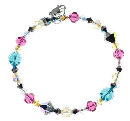 Candy colored crystal bracelet. Swarovski crystal pink, teal and yellow pattern on memory wire and sterling silver.