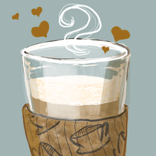 A latte glass with little coffee hearts above it. Mmm!