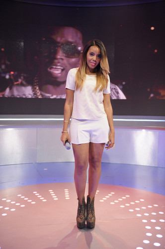 Angela Simmons wearing Luichiny Rose Anna in Army Green, as she hosts a show on BET