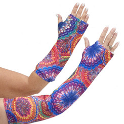 Long and short arm cast cover in bright blues, oranges, yellows, and red in a kaleidoscope pattern.