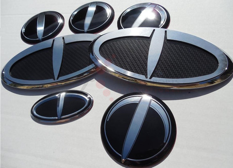 """2012+ Rio Pride Hatchback K2 LODEN """"T"""" Carbon/Stainless Steel Badge Emblem Grill Trunk Caps Steering 7pc"""