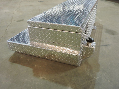 52 Gallon Aluminum Auxiliary Fuel Tank and Toolbox Combination Designed for use with a Roll-Top Bed Cover. Made by: Aluminum Tank & Tank Accessories, Inc. 1-800-773-3047.