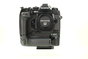 Olympus OMD E M1X, front view with camera quick release plate.