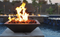 Square Copper Fire Pit: As shown, hand-hammered copper finish, lava rocks and The Fenix Perfect Flame Electronic Ignition system.