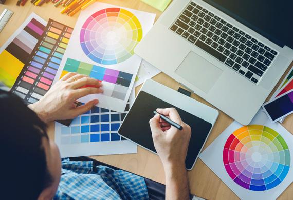 Graphic designer working with software on portfolio