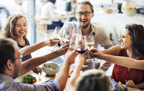 Diners toasting milestones in restaurant