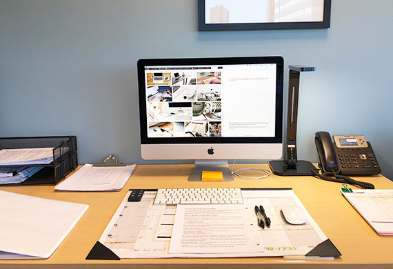 Working at an organized desk increases productivity and efficiency
