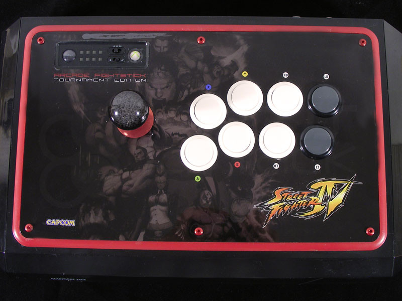 M4x12mm screws installed into MadCatz Tournament Edition joystick (red anodized screw displayed)