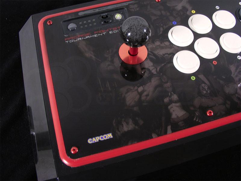 M4x12mm screws installed into MadCatz Tournament Edition joystick (red anodized screw displayed)