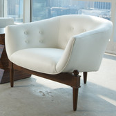 sleek modern chair with warm wood accents unique three leg design perfect for those sought after modern accents to complete the chic rooms of todays modern family