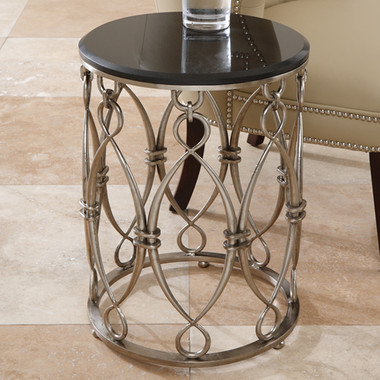 """Global Views Bow Loop Table Dimensions: 15""""DIA x 20""""H Antique nickel finish on iron; Black granite top"""