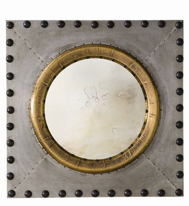 We love the mix of the antiqued gold metal wrap around the mirror in conjunction with the raw zinc and bronze over-sized nail heads.