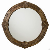 This round solid wood mirror features rich carved detailing in a sandblast antique waxed finish