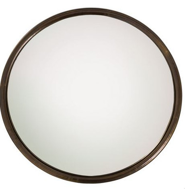 The Gervais Mirror features an antique brass clad frame circling a round convex mirror.