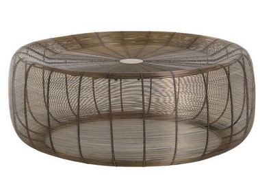 Vintage brass wires are hand wrapped around the iron frame to create a nest-like structure that exudes volume without weight. This Hadrien Cocktail table is perfect with a sectional.