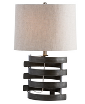 Concentric circles are a major design trend, and this hand-forged natural iron lamp with interlinking horizontal bands is a bold elliptical silhouette that speaks to that inspiration.