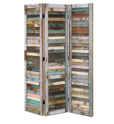 the Medina Folding Screen is crafted from reclaimed house shutters. Though similar in color and patina, no two are identical. The Medina Folding Screen showcases true rustic charm.