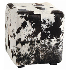Large squares of black and white hide are sewn together to create a patchwork pattern. Hide patterns will differ and color will vary.