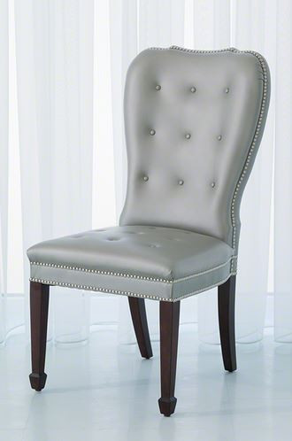 The Charleston chairs are classic shapes updated in scale and comfort. The chairs have a solid wood frame and web seating construction padded with foam and Dacron wrap. They are covered in a gray finish cowhide leather.