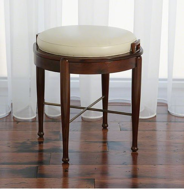 Dual function stool, this walnut finish stool with metal crossbase has a top that is removable and will flip to reveal a ivory leather cushion for extra seating or a smooth table top.