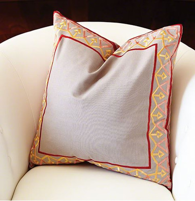 The bezel border pattern is inspired by an antique air vent register. Realized in an embroidered pattern in a contrasting color around a cotton pillow. Pattern on front and back.