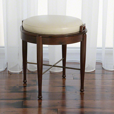 A walnut flip round stool with ivory leather from Global Views.