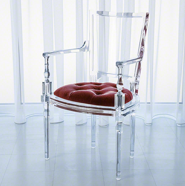 A marilyn acrylic arm chair with a red base from Global Views.