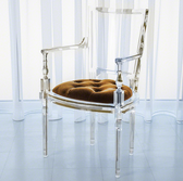 Italian design and molded chair with brown sugar gold tufted seat.