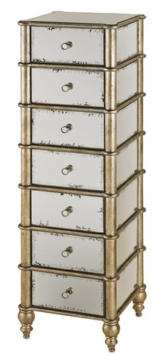 The alluring Harlow Seven Drawer Chest features Hollywood Regency styling and exquisite detailing. A multi-step Silver Leaf finish adorns the wooden frame and several beautifully Antiqued Mirror panels accent the top, sides and drawer fronts of the chest.