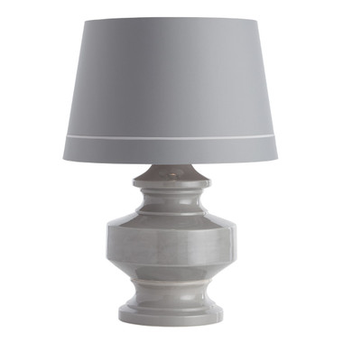 This ceramic table lamp features a timeless gray finish and classic, cinched-in profile. The lamp is topped with a gray microfiber tapered shade that is lined in cloud gray with a contrasting trim detail. Finish may vary. MSRP: $ 750.00
