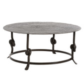 This round cocktail table perfectly represents the essence of artisan design and craftsmanship. First, note the unique texture of the hand-hammered top, and then the solid iron bar that has been hand-forged into a curvaceous knot detail on each leg. The natural iron finish keeps it simple and reinforces the organic nature of the design. Round cocktail tables are inviting and without the sharp corners are children and pet friendly.