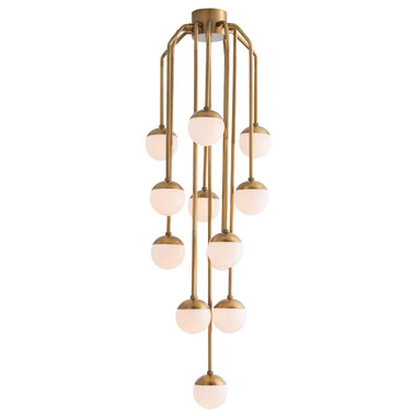 Vincent Fixed Chandelier H: 62in Dia: 25in Thirteen opal glass spheres descend effortlessly from an antique brass canopy, eliciting a weightlessness as if they were floating through the air. Perfect for a staircase or other vertical space that needs drama and light. Approved for use in covered outdoor areas.