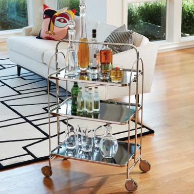 """Whether you are hosting a party or just having a casual cocktail at home, do it in style with our Plaza Bar Trolley. The nickel tube frame holds three black powder painted shelves for ample display space. The whole piece glides easily across a room on wheels of smooth rubber and metal. 28.75""""L X 20.75""""W X 30.75""""H"""