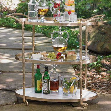 """This brass bar cart compliments the natural motif of our Arbor collection. It has twig textured detailing on the supports and handles, a solid white marble bottom shelf, and two glass upper shelves. Solid brass pivoting wheels make for easy mobility. 42.75"""" L X 20"""" W X 37.5"""" H"""