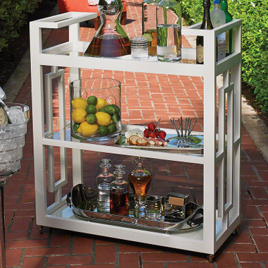 """Reminiscent of the entertainment of the mid-century, the Grid Block Bar Cart captures the geometric architecture and furniture of the time period. The matte white lacquer finish brings a sophisticated elegance to this modern design. Features integrated handles, three tiers of removable glass shelves, and fully rotational cast brass wheels.  36""""L x 16""""W x 42""""H"""