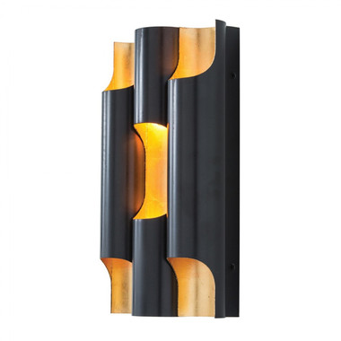 In the Wolfe Sconce, steel is transformed with two paradoxical finishes. While a masculine bronze finish covers the outside, a more delicate gold leaf is applied on the inside to better reflect light and create an impactful visual contrast. This sconce is damp rated so consider using a few of them down a covered walkway outside.