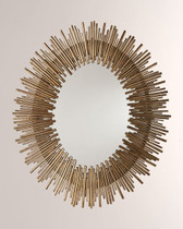 """Large-scale oval wall mirror features a sunburst pattern with a rim of thin textured iron reeds in multiple lengths in an antiqued gold leaf finish. Actual Mirror Size:22 x 16"""" Oval Overall Dimension D:1.5in Overall Dimension H:40.5in Overall Dimension W:34in"""