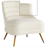 Sink into the rolling landscape of the Dune Chair. A lounger designed for comfort in every way, the sleek channeled form and tapered antique brass legs are elegantly effortless. The seat is covered in muslin, allowing you to slipcover or reupholster in the fabric of your choice. Finish may vary. White Muslin Windsor Smith Designer